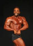 Bulging, Bearded Bodybuilder Displays Winning Form Royalty Free Stock Image