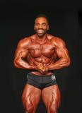 Bulging, Bearded Bodybuilder Displays Winning Form Stock Images