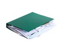 Bulging green binder filled with paperwork Royalty Free Stock Image