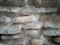 Bulging stoned wall background texture stock photo