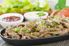 Bulgogi. Korean grilled marinated beef in a sizzle pan Royalty Free Stock Photography