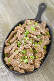 Bulgogi. Korean grilled marinated beef in a sizzle pan Stock Images