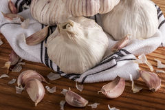 Bulgs of garlic on wooden table Royalty Free Stock Photos