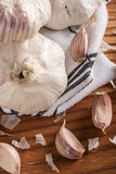 Bulgs of garlic on wooden table Royalty Free Stock Photo