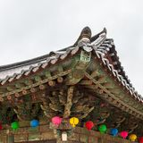 Detail view on roof of korean buddhist Bulguksa Temple with many lanterns to celebrate buddhas birthday on a clear day. Located in stock photography