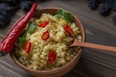 Bulgur avec le poivre et le persil Photos stock