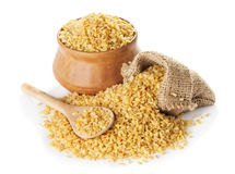 Bulgur  in a bag and clay bowl Royalty Free Stock Photos