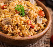 Bulgur with chicken, mushrooms and tomatoes Royalty Free Stock Photography