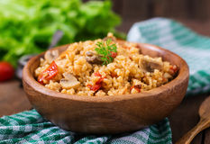 Bulgur with chicken, mushrooms and tomatoes Stock Photos
