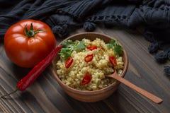 Bulgur con il pomodoro ed il pepe Fotografie Stock