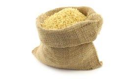 Bulgur (couscous) in a burlap bag Royalty Free Stock Images