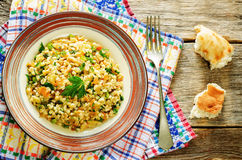 Bulgur with eggplant and greens Stock Images