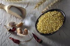 Bulgur and garlics Stock Photography