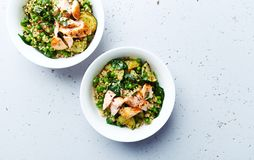 Bulgur with green vegetables and poached salmon. Healthy homemade meal stock photos