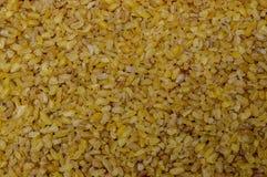 Bulgur het close-upachtergrond van de tarwe natuurlijke natuurvoeding stock afbeelding