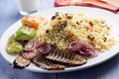 Bulgur pilaf with grilled vegetables Stock Image