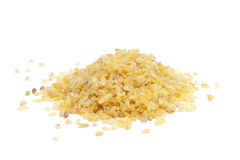 Bulgur. A pile of bulgur on white background royalty free stock images
