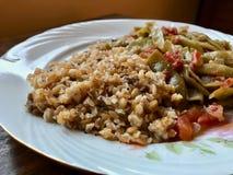 Bulgur Rice made with Siyez Unu Einkorn Flour Triticum monococcum with Green Beans Zeytinyagli Fasulye / Pilav or Pilaf. stock photography