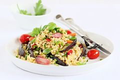 Bulgur salad with vegetables and herbs Stock Image