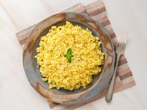 Bulgur wheat. Boiled bulghur cereal in plate on white marble table. Healthy vegetarian food, top view.  stock image