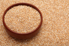 Bulgur wheat in bowl Royalty Free Stock Photography