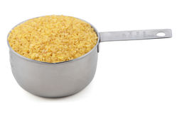 Bulgur wheat in a cup measure Stock Images