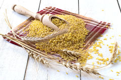 Bulgur and wheat ears Royalty Free Stock Photos