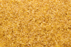 Bulgur wheat grains forming textured background Stock Photo