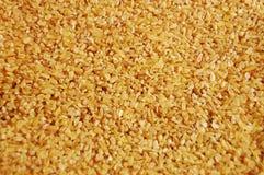 Bulgur wheat groats. Closeup of bulgur wheat groats stock image