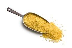 Bulgur wheat in metal scoop Stock Photo