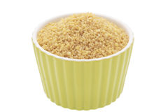 Bulgur wheat. Uncooked bulgur wheat in a bowl on a white background Royalty Free Stock Image