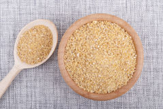 Bulgur in a wooden bowl. Stock Photography