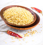 Bulgur in a wooden plate Stock Image