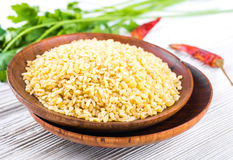 Bulgur in a wooden plate Royalty Free Stock Images