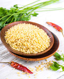 Bulgur in a wooden plate stock photography