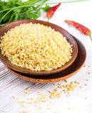 Bulgur in a wooden plate with red royalty free stock photography