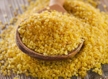 Bulgur in a wooden spoon Royalty Free Stock Photography