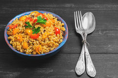 Bulgur with yellow and red cherry tomatoes Stock Photos