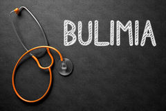 Bulimia - Text on Chalkboard. 3D Illustration. Royalty Free Stock Photography