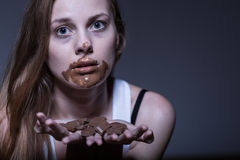 Bulimic girl and snack Royalty Free Stock Photos