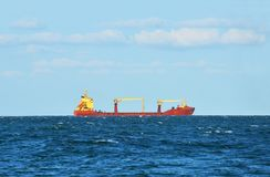 Bulk cargo ship on horizon Stock Photo
