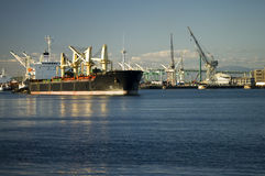 Bulk Cargo Ship Leaving Port. A bulk cargo ship departs the port of Los Angeles in late afternoon royalty free stock images