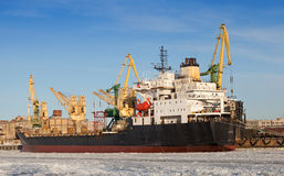 Bulk cargo ship loading in winter port Stock Photography