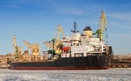 Bulk cargo ship loading in winter port. Bulk cargo ship loading, port of St.Petersburg, Russia Stock Photography