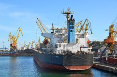 Bulk cargo ship under port crane. Bridge, Odessa, Ukraine royalty free stock photo