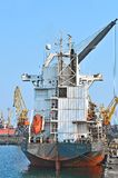 Bulk cargo ship under port crane Royalty Free Stock Image
