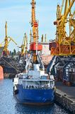 Bulk cargo ship under port crane Stock Photos