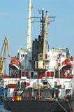 Bulk cargo ship under port crane Stock Images