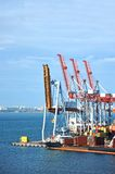 Bulk cargo ship under port crane Royalty Free Stock Photography