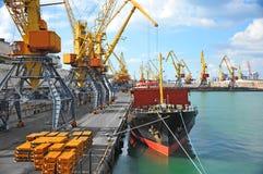 Bulk cargo ship under port crane. Bridge, Odessa, Ukraine royalty free stock photography